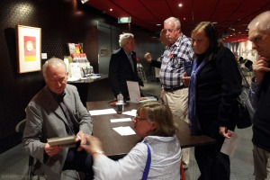 Peter Rees signing copies of his book