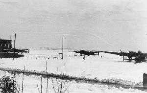 Waddington Lancasters in the snow, February 1944. Photograph taken by the Station medical Officer, Flight Lieutenant Howarth. The control tower is visible at the left of shot. From the Waddington Collection, RAF Waddington heritage Centre