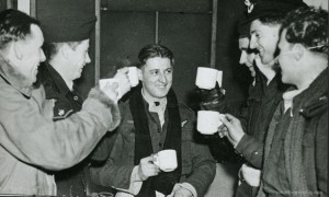 Raising a mug at Waddington to their rear gunner (Sgt Cliff Fudge) after the Berlin raid of 15 February 1944 is the crew of Pilot Officer John McManus (on right in hat). It was Fudge's 21st birthday. The Waddington Collection, RAF Waddington Heritage Centre