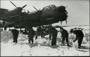 Clearing snow at Waddington, probably February 1944. The original caption identifies Fred Smith as the centre one of the five men with shovels. From the Waddington Collection, RAF Waddington Heritage Centre