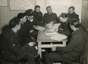 The Buckham crew at debriefing after Juvisy, 18APR44. Left to right, they are: F/S EJ Holden, Sgt W Sinclair, F/O RW Broad, F/O BA Buckham, F/O EH Giersch, F/S LJ Manning, P/O A Giles (Intelligence Officer) and F/O JW Muddle