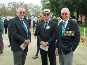 Squadron Leader Dave Helman with Group Captain Robert Black AM RFD and Wing Commander Bob Macintosh AFC MID