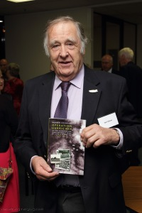 Ian Gibson with his prize, a Fighting High book donated by Capricorn Link (Australia)