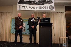 Ron Houghton launching a new book, called Severed Wings about a Bomber Command crew who were shot down and bailed out over Germany. Four members of the crew were subsequently murdered by German civilians. Looking on is the RSL's Ken Doolan and Peter Rees