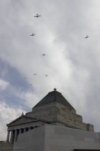The Royal Victorian Aero Club formation passes the Shrine of Remembrance